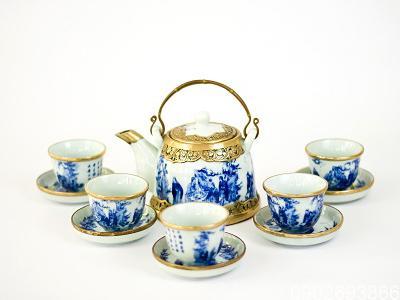 Bộ ấm trà Bát Tràng men xanh vuốt tay S2 bọc đồng